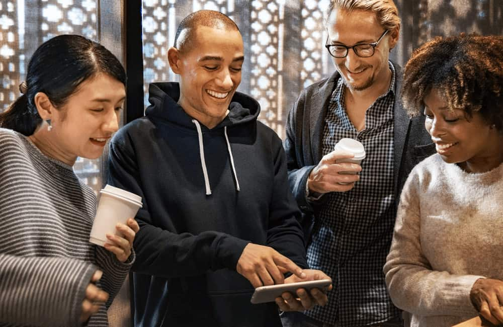 Cheerful people looking at smartphone